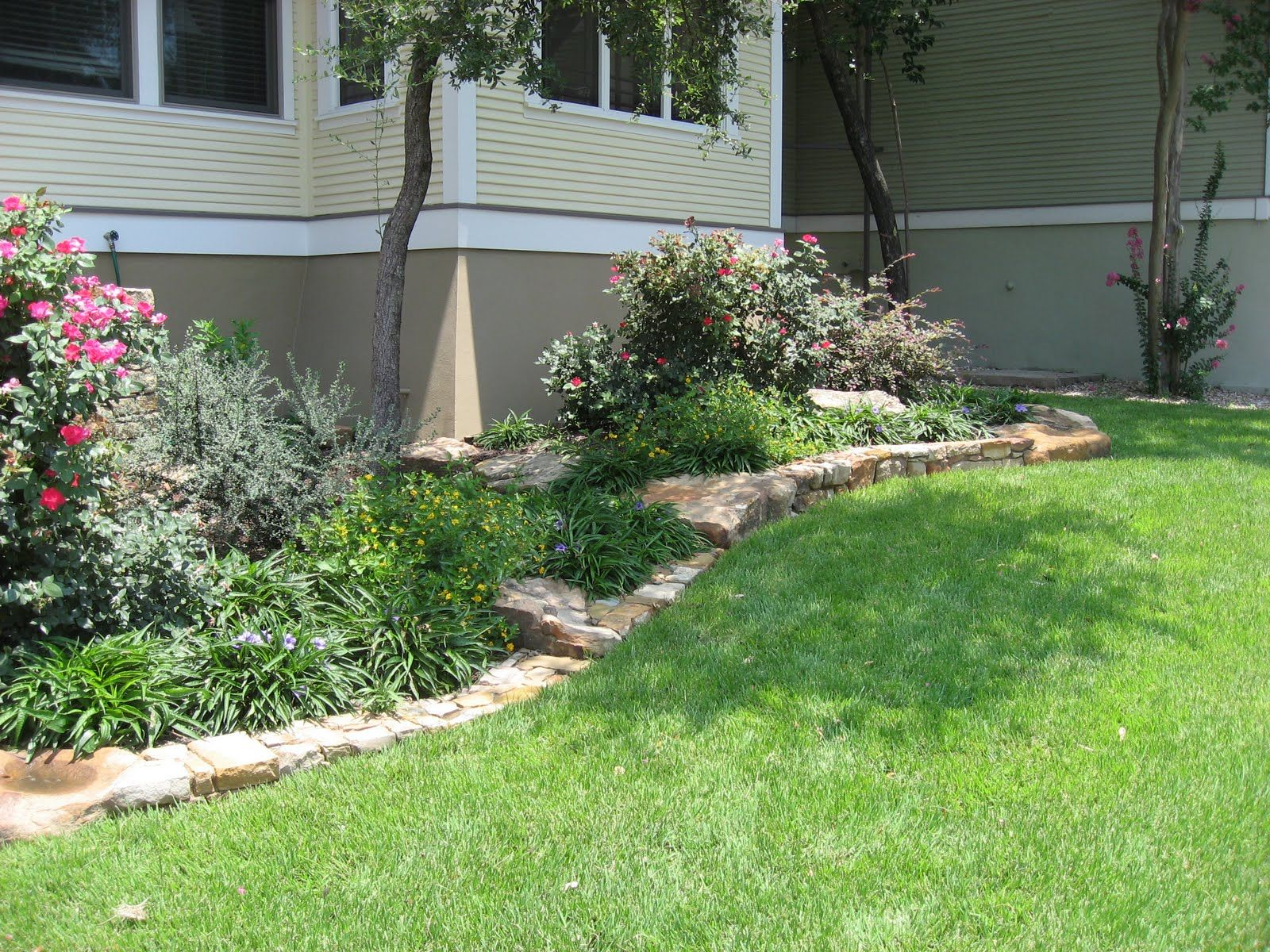 Terrific Landscape Pink Flowers Bed Edging with Stone Base Design ...