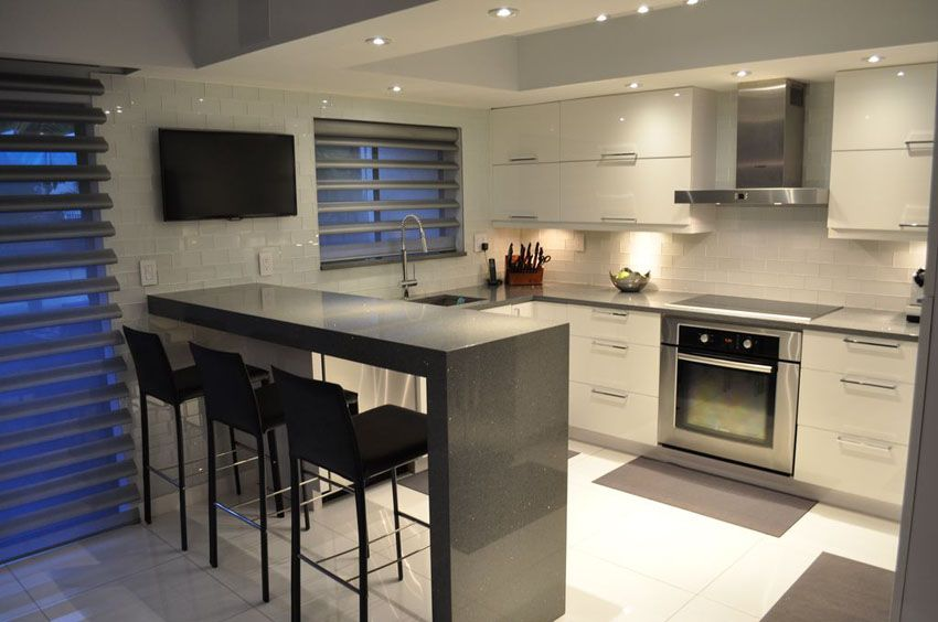 Delightful Small Modern Kitchen With Gray Quartz Counter Peninsula And White Gloos  Cabinets