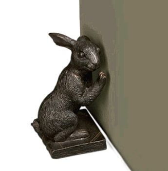 Hold your doors with our cast iron rabbit door stop shown here in a  beautiful antique