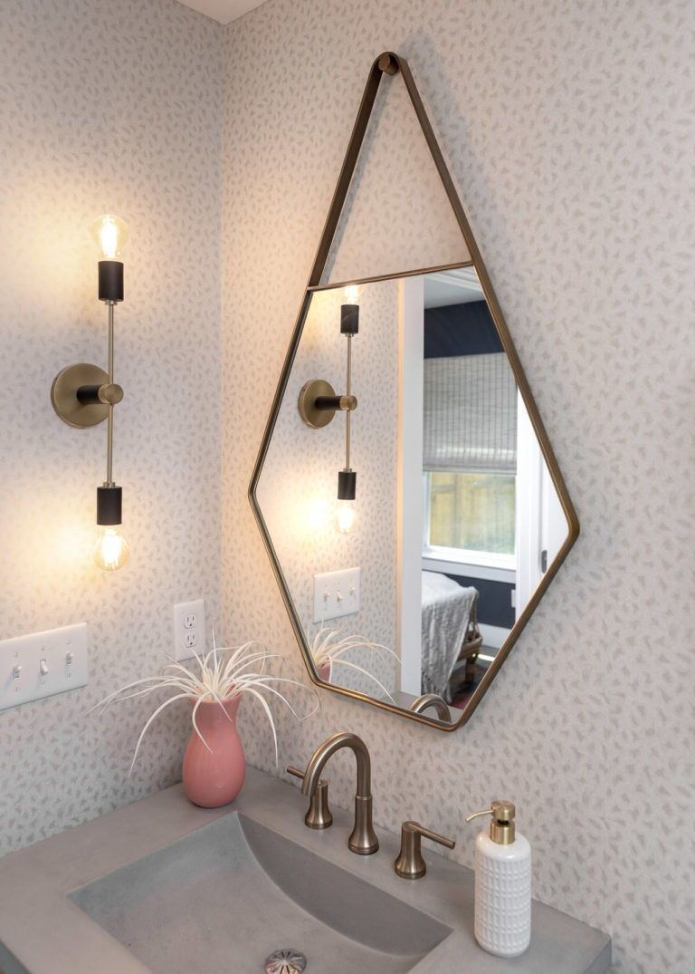 Decorating your bathroom does not need to be boring! This beautiful mirror adds a sleek finish to your sink area. Click for a full tour of this incredible new tiny home!     #tinyhome #bathroom #bathroomdecoration #bathroommirror #bathroomsink #bathroomrenovation #homerenovation #coolmirrors #indetailinteriors
