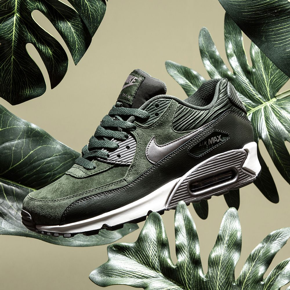 Treat yourself to the Nike Womens Air Max 90 Leather Trainer in carbon  green & metallic