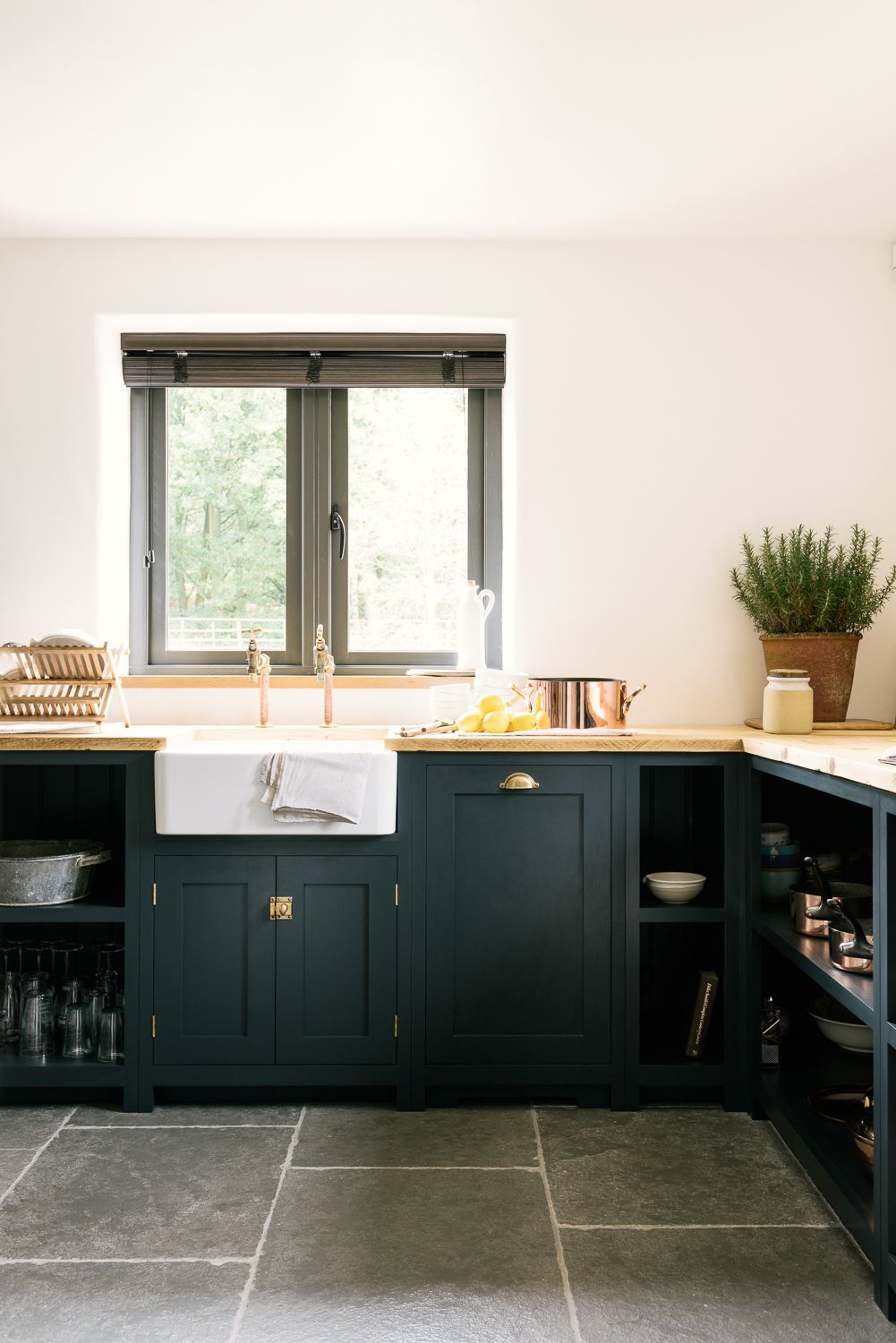A Farmhouse Sinks, Brass Taps And Dark Blue Shaker Cupboards In DeVOLu0027s  Leicestershire Kitchen In The Woods