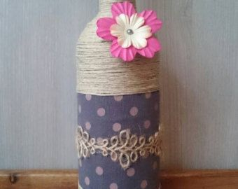 A twine and yarn wrapped bottle for decoration. Makes a lovely item by itself and looks even better with others.  Height: 30 cm Diameter: 7 cm  Packages to other countries than listed are possible, but may have higher shipping costs. If you have any other wishes regarding colours, shapes or sizes please let me know.