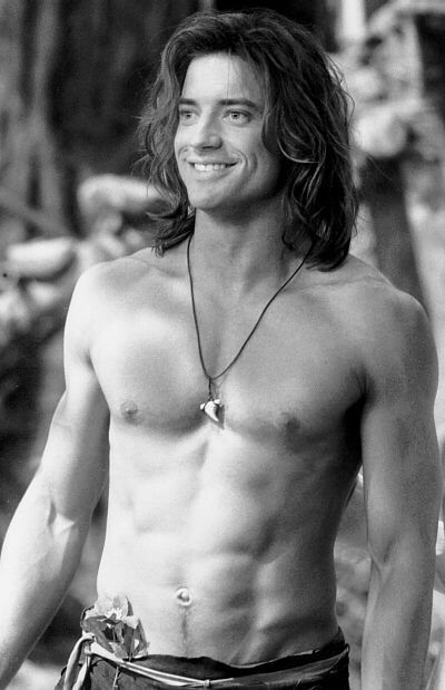 Brendan Fraser, especially in his George of the Jungle and Mummy days.  Cute, hot guy!  And yummy . . . very yummy . . .