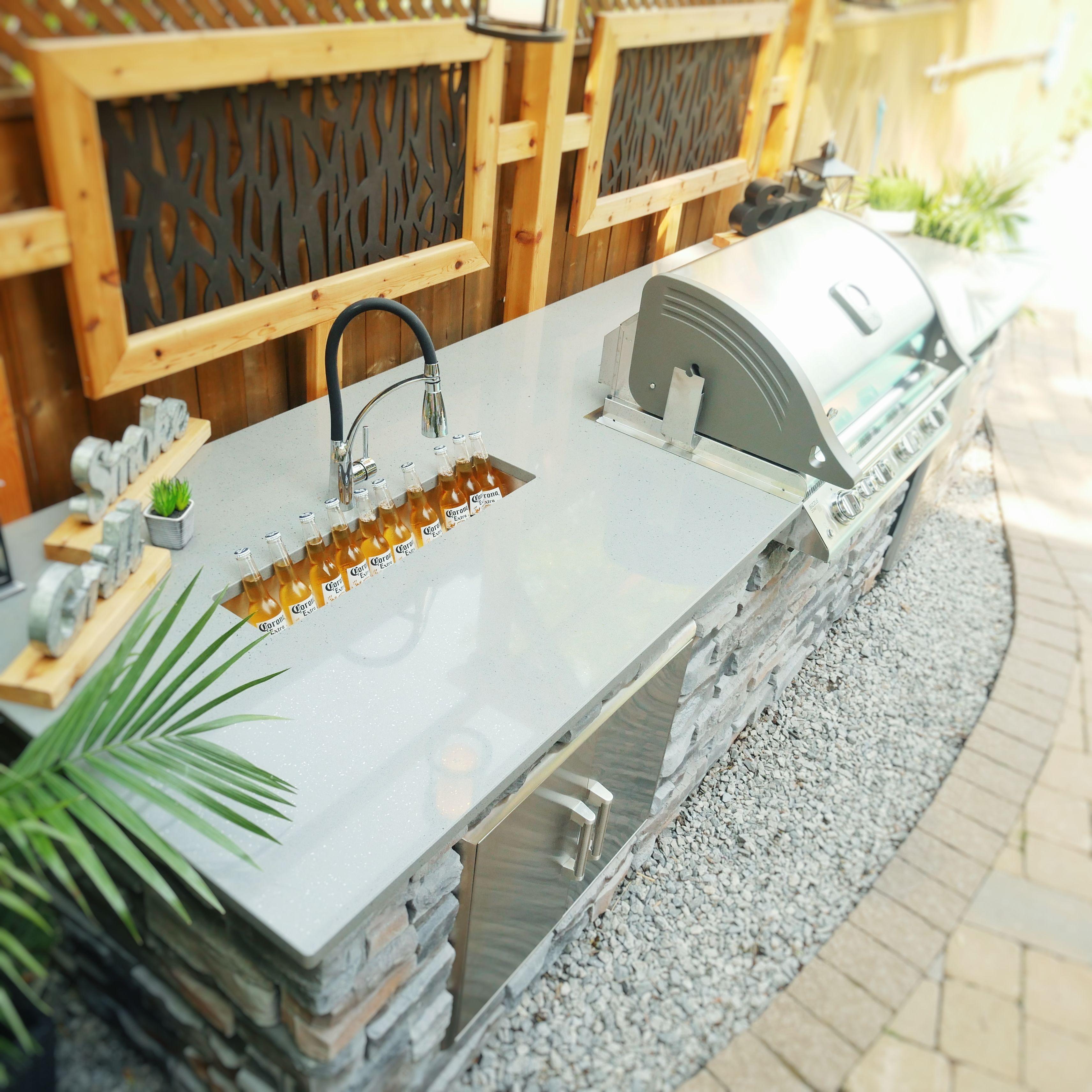 outdoor kitchen with quartz counter stone surround trough sink fridge and bbq an on outdoor kitchen quartzite id=77354