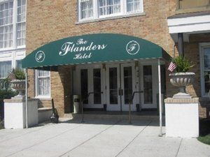 The Flanders Hotel By The Oc Boardwalk Ocean City Hotel Exterior The Good Place