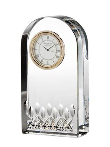 An elegant Lismore Essence Clock framed by fine crystal, perfect for any desk, mantle or bedside table.