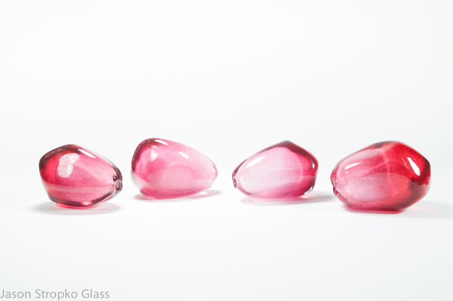 Dark Rose Pomegranate Seeds, made by Jason Stropko  qualities: partially translucent, light catching and reflective.   Contact Jason via his Facebook page