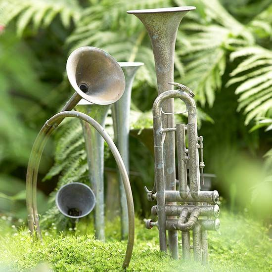 Play to Your Personality- really different & not my style but..........  The number one thing to keep in mind in designing a garden is that your garden needs to fit your personality. So find ways to incorporate things you like in the garden. It may be garden art, such as the instruments here, or particular plants or even certain color combinations