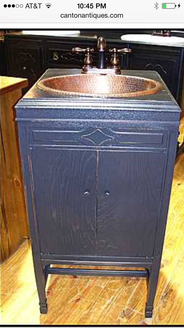 This antique Victrola cabinet was re-purposed to be a bathroom vanity. And  this - This Antique Victrola Cabinet Was Re-purposed To Be A Bathroom