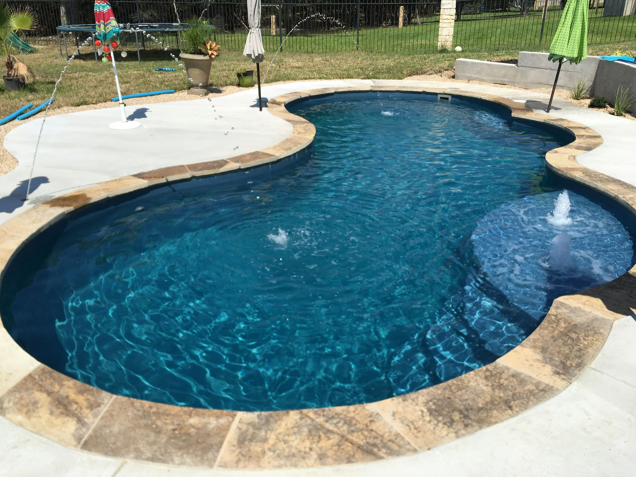 This 16 X 32 Gemini Shaped Fibergl Inground Pool Complete In Vega Color Sandstone Coping And Bubblers Is The Perfect Backyard Escape
