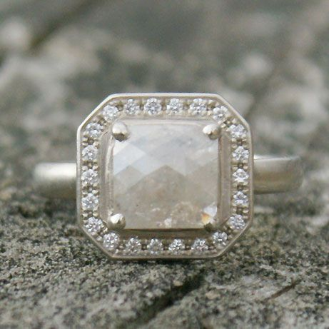 This one of a kind ring has a beautiful claw set square opaque grey