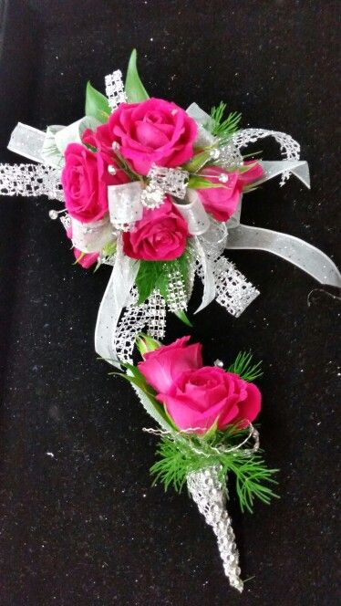 Hot pink spray roses with white and silver accents