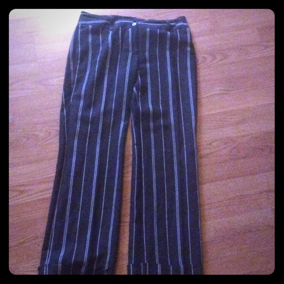 Ann Taylor lined linen pin stripe dress pants These pants are size 6 Ann Taylor. They are linen and lined with pinstripe design. They are brown with crime pinstriping. Back pockets have but to and a double button front waistband. Very flattering and perfect for work. The bottom is cuffed. Excellent condition. Ann Taylor Pants Trousers