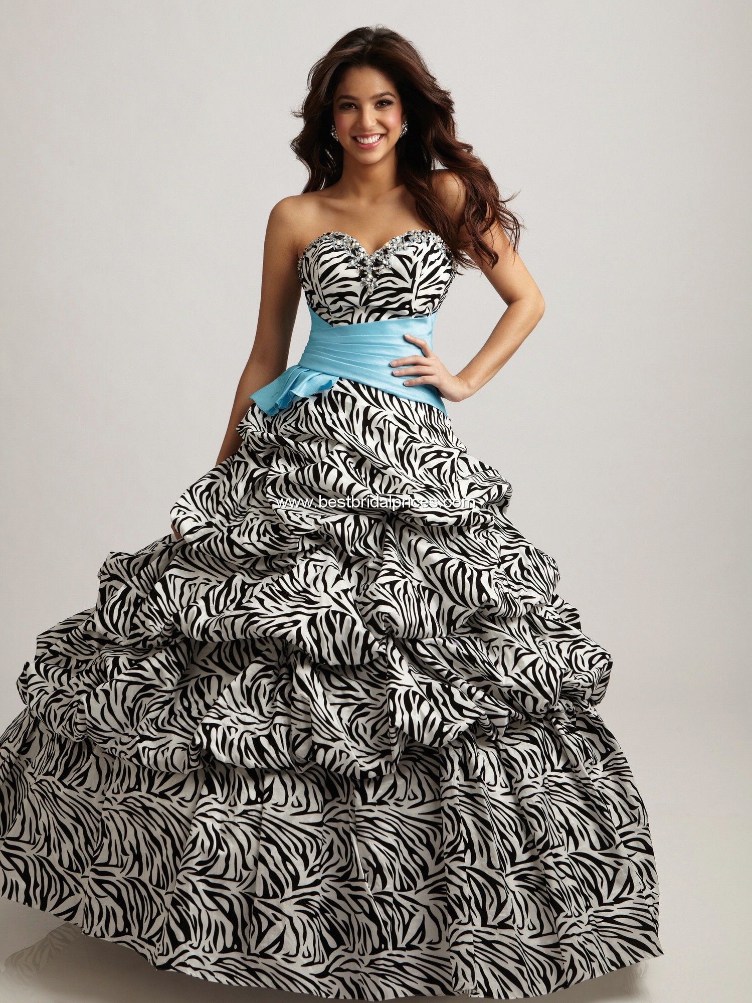6459eb4c1bb Break up the zebra print with a plain colored ribbon at your waist and complement  this