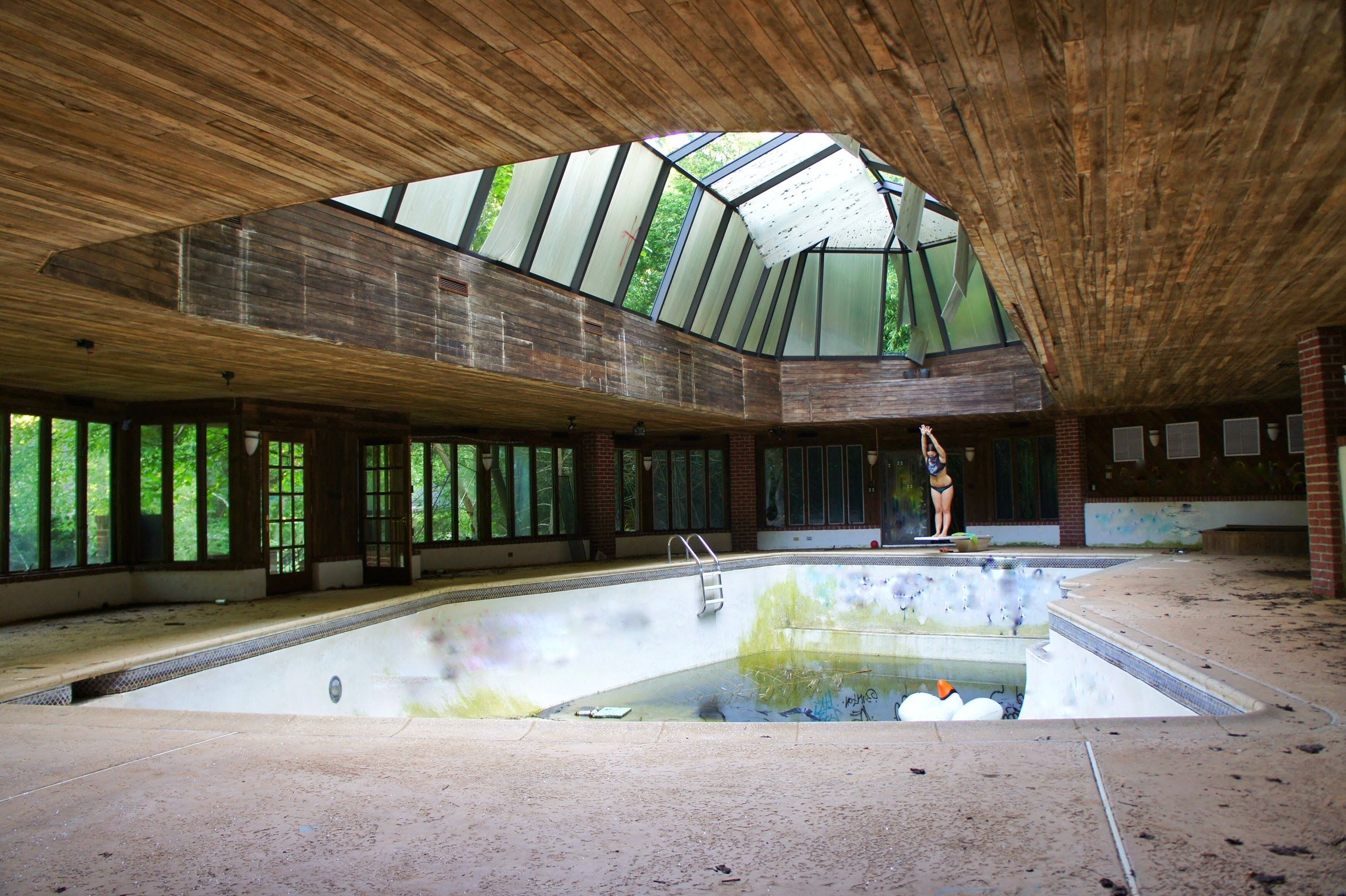 abandoned bankrupt tennis players mansion with indoor pool tennis court