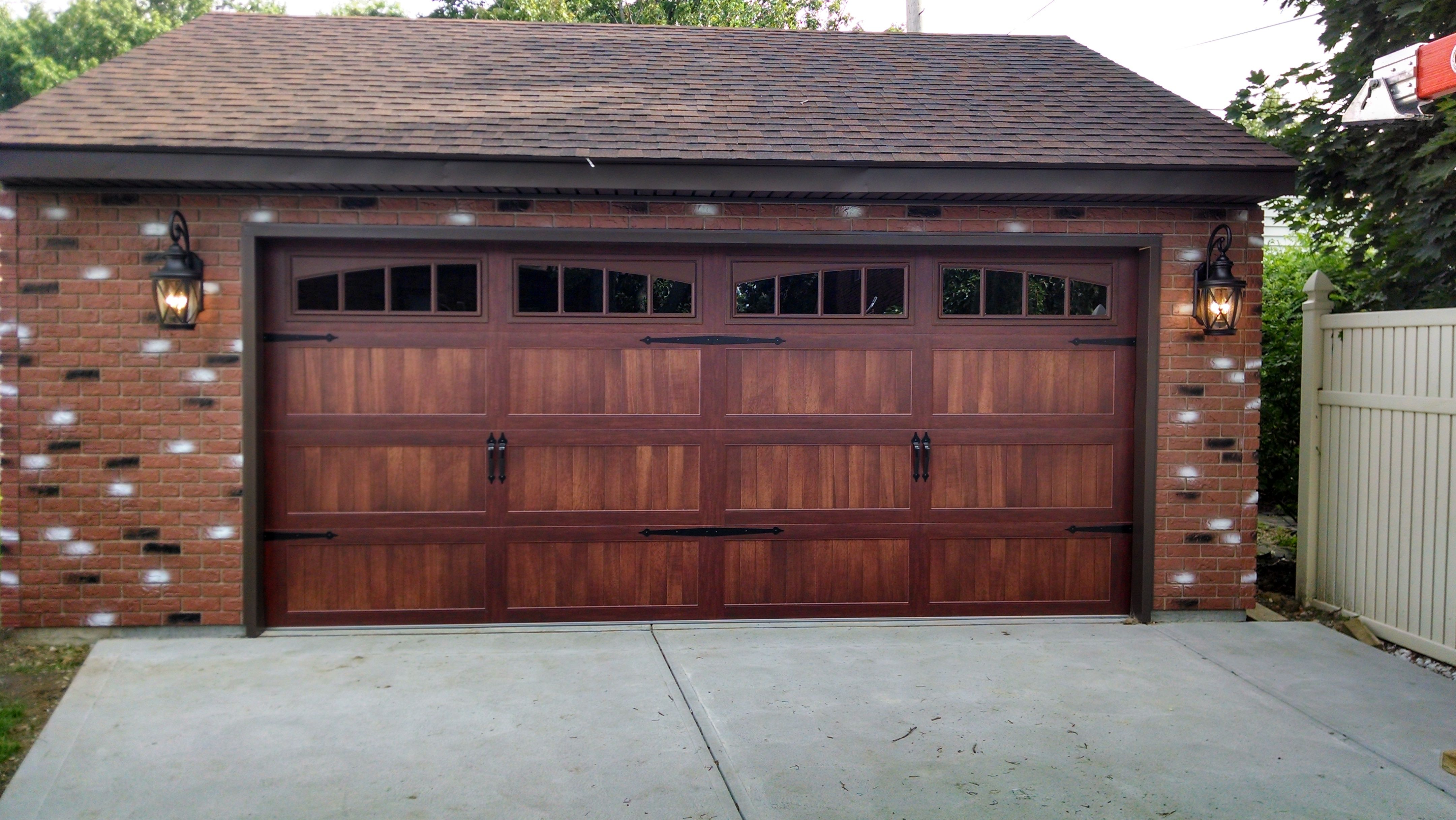 5916 C H I Mahogany Long Panel Carriage House With 2 2 Piece Arched Madison Garage Door Styles Garage Door Lights Overhead Door