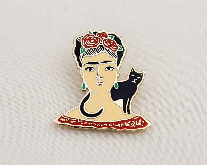Frida Kahlo enamel pin with a black cat friend. The perfect lapel badge to show your love for the Mexican artist. Made with hard enamel and gold-plating. #accessory #artist #badge