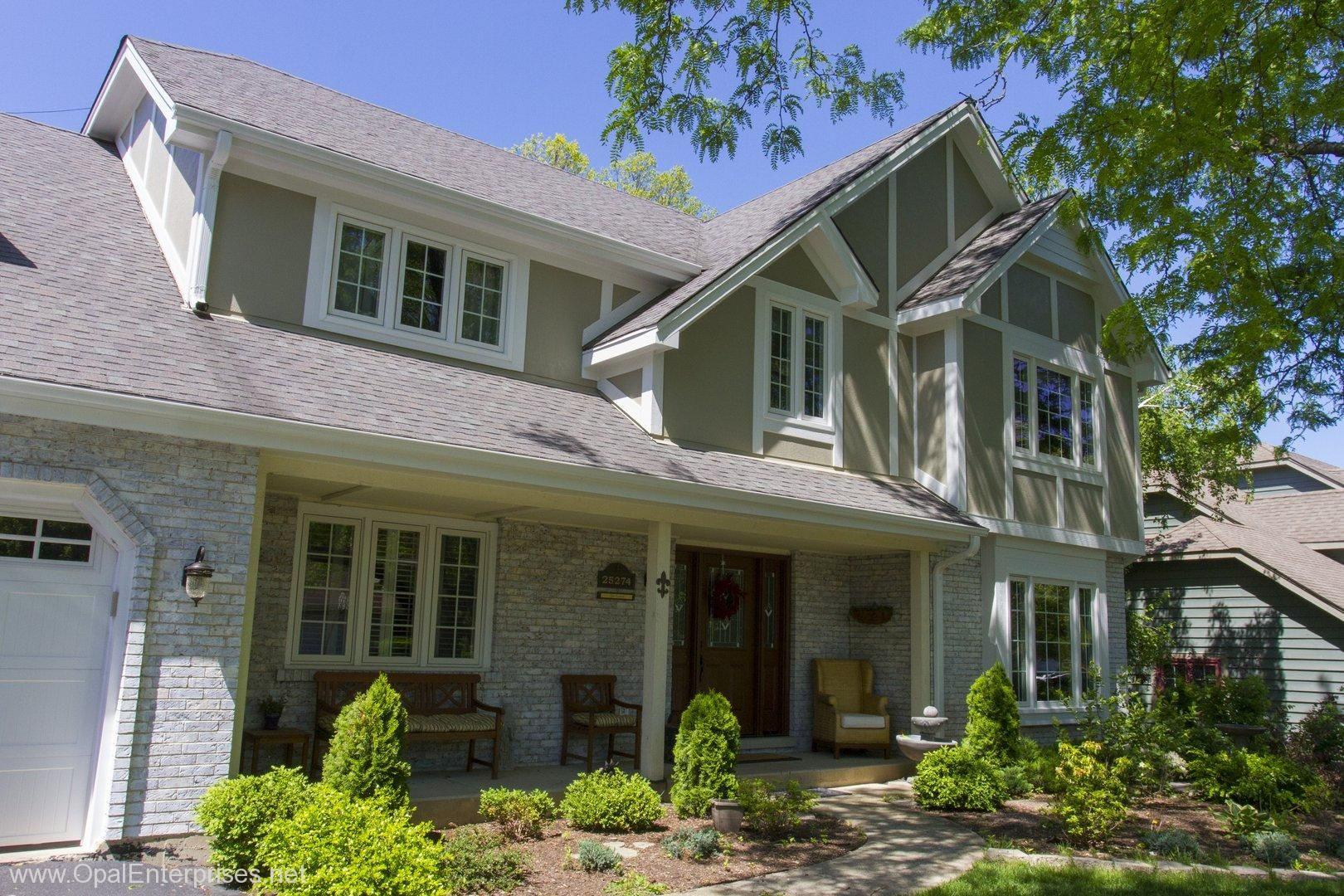 Stylish Stucco And Trim Siding Distinguishes This Newly Remodeled Home Exterior House Renovation Siding Trim House Exterior