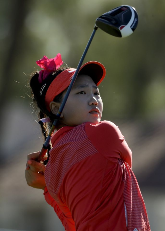 49a8efdc4f0 Lucy Li watches her tee shot on the third hole during the first round of  the LPGA Tour ANA Inspiration golf tournament at Mission Hills Country  Club