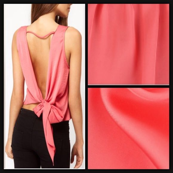 Pink Backless Top Condition: Brand New NWOT Size: XS-S Material: Polyester Color: Pink Neckline: Round Details: Ties in back. Semi-Crop. Tops Blouses