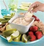 Peanut butter vanilla yogurt fruit dip.  Click here for recipe: http://www.food.com/recipe/peanut-butter-yogurt-dip-137167    Some people add additional things like cinnamon or even mini chocolate chips.  But I think it is delicious with just the peanut butter and yogurt.