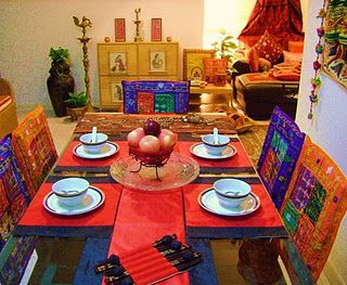 Indian Dining area - love the chair covers!