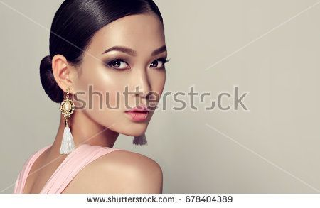 shoulder looking over Asian model