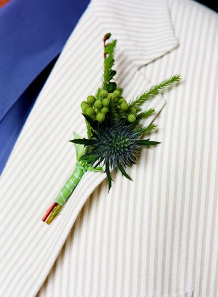 green and navy boutonniere