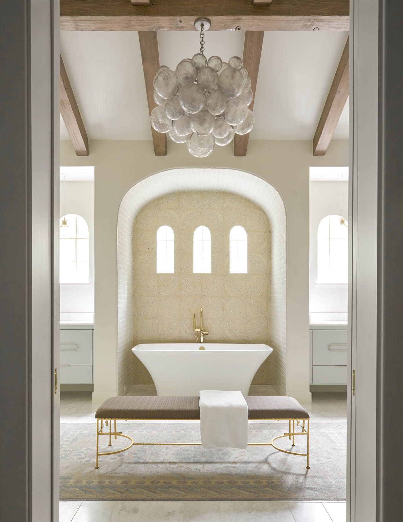 Grand bathroom design with stand alone tub, wooden beams and ...