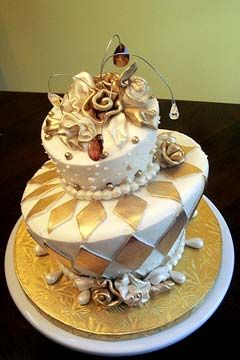 Two tier, mad hatter, white and gold wedding cake, decorated with ...