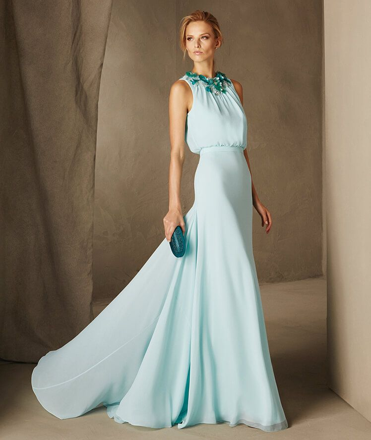Regal floor-length gown with a flared skirt and jewel neckline ...