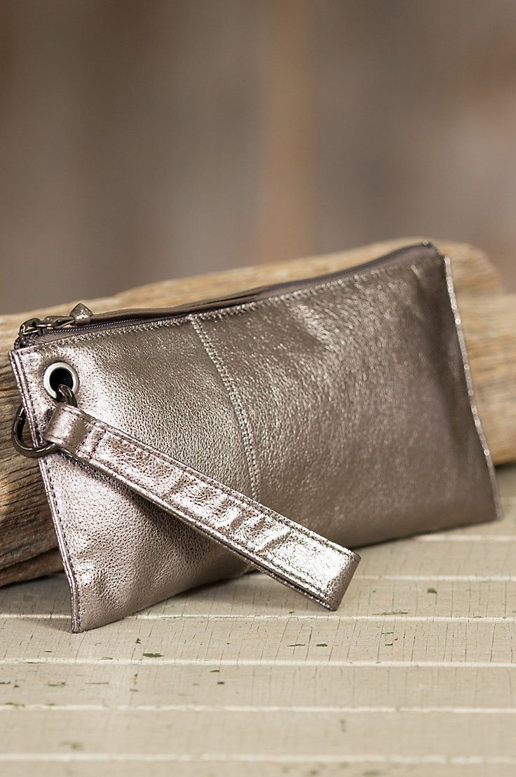 fdbac983b8 The Vida Leather Wristlet is crafted from top-grain leather that s been  tumbled for a charming broken-in look with a soft sheen.