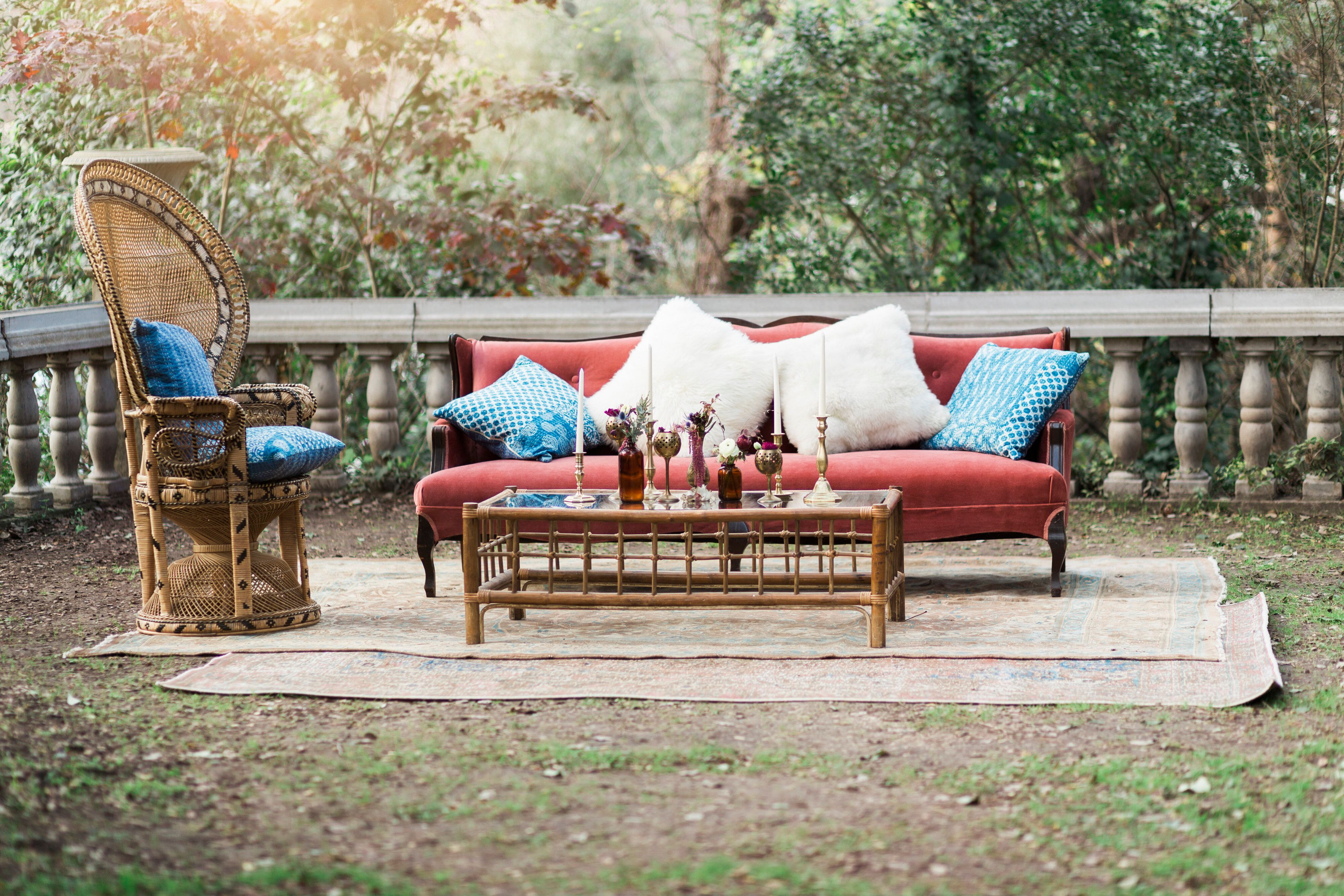 Bohemian Outdoor Bridal Lounge With Peacock Chair And Berry Pink