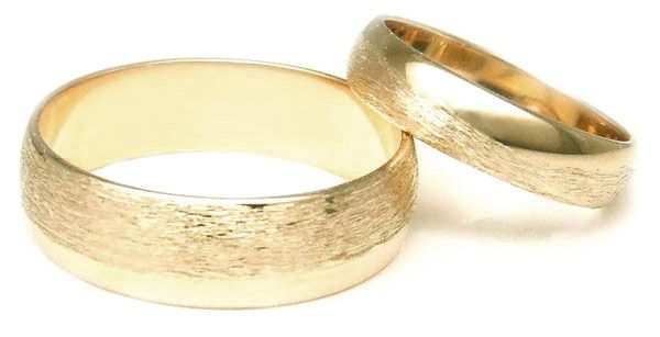Yellow gold wedding ring set with rounded edges and a rough, grit texture applied to portions of the band.