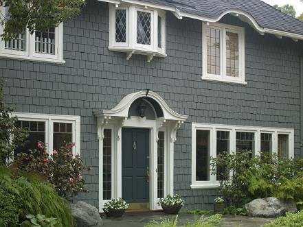 The Traditional Front Door Is Painted A Deep Navy Turquoise To Complement Slate Gray Wood Shingle Siding
