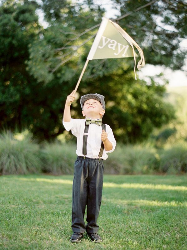 Love the idea of the flower girls and page boy waving flags down the aisle! Could write some crazy stuff on them!