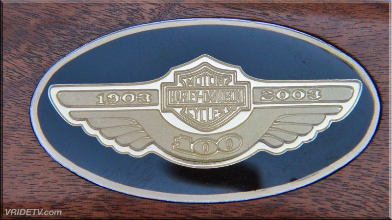 """Solid silver 100th anniversary medallion is set in the handle of this imited edition stainless steel bowie knife measures 10"""" in length and features mirror-polished blade, which is etched and gold plated to depict Harley-Davidson's founders. A solid silver 100th anniversary medallion is set in the handle, which is bordered by an engraved nickel silver handguard and bolster. Over all it is 15 inches in length from tip of blade to butt of handle. for sale at http://www.vridetv.com/knife.html"""