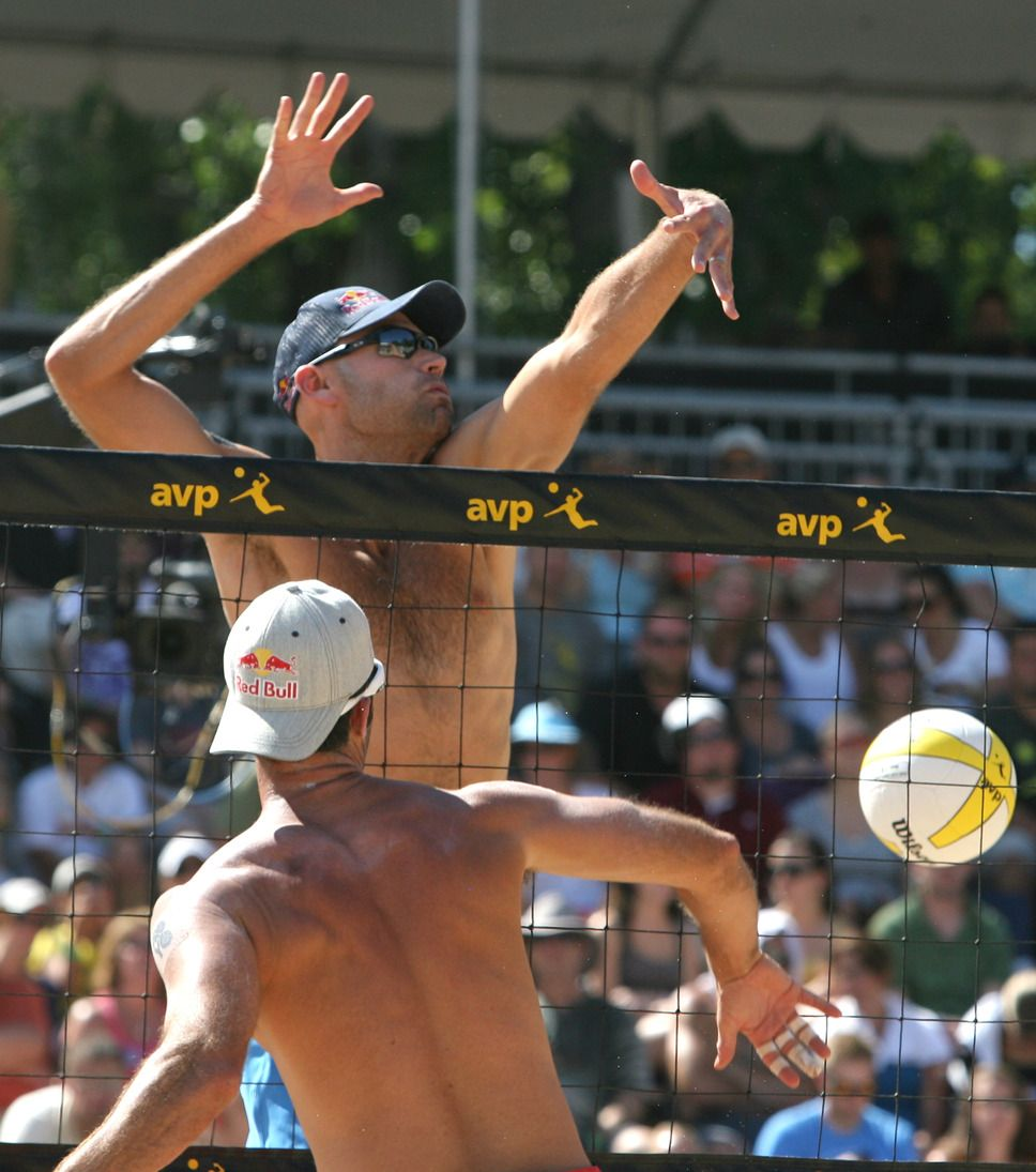 Rick Egan The Salt Lake Tribune Todd Rogers Hits The Ball As Phil Dalhausser Defends In The Men Avp Volleyball Volleyball Tournaments Beach Volleyball