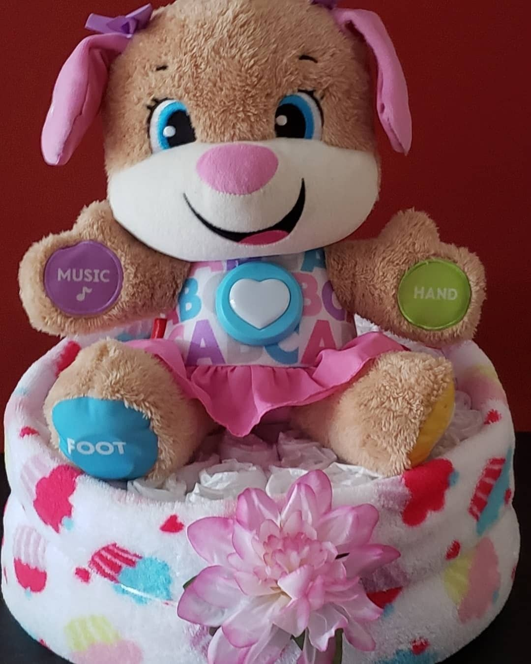 Its a girl fisher price laugh and learn puppy diaper cake