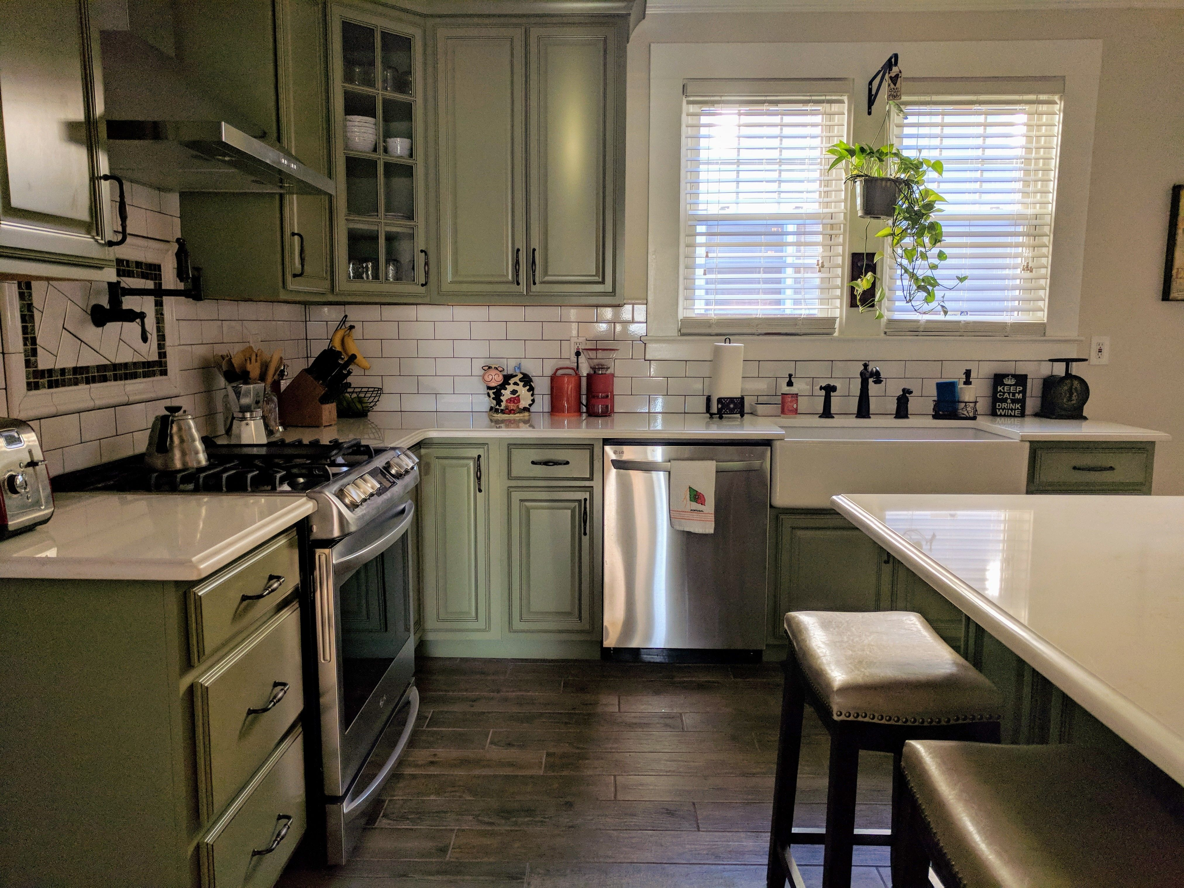 American Foursquare Kitchen Sage Green Cabinets White Subway Tile Dark Grout Wood Tile Floor Quartz Cou Kitchen Remodel Green Cabinets Green Kitchen Walls