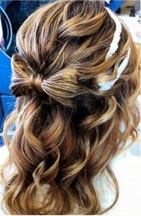 Cute half up/half down hairstyle.