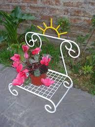 Resultado de imagem para porta maceta de hierro para for Figuras jardin baratas