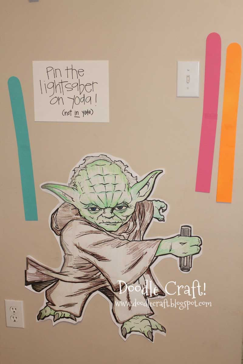 Pin the Light Saber on Yoda. Cute for quiet book for my kids since my husband loves star wars.