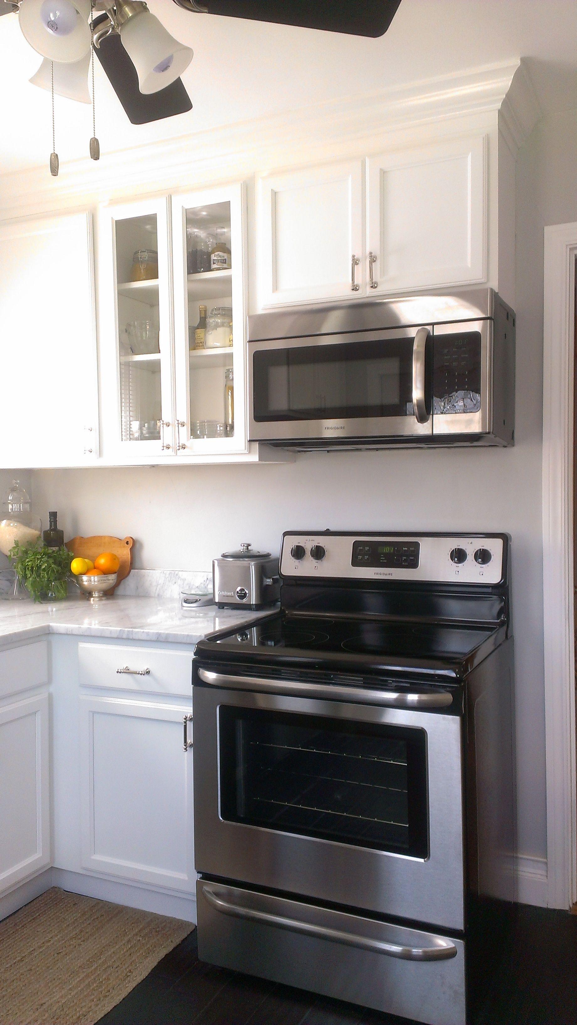 Small Kitchen White Cabinets Carrara Marble Countertop Dark