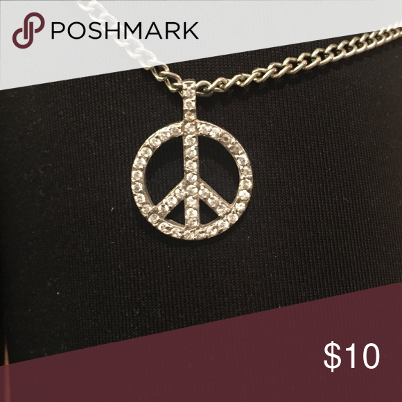 Peace necklace Peace sign necklace covered in clear/white gems. The peace sign is about the size of a nickel Jewelry Necklaces