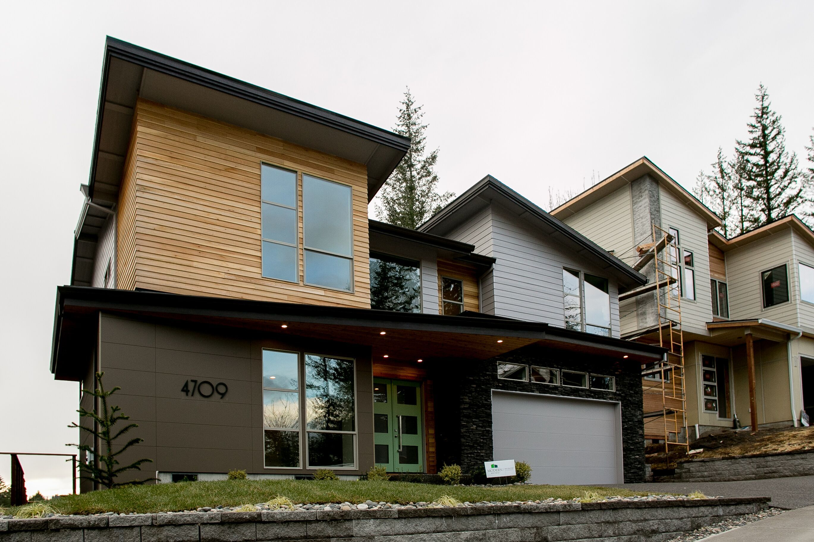 Become The Neighborhood Trendsetter Deep Mocha Architecturalblock Sets A Handsome Tone For This Modern Portla In 2020 House Styles Curb Appeal Curb Appeal Inspiration
