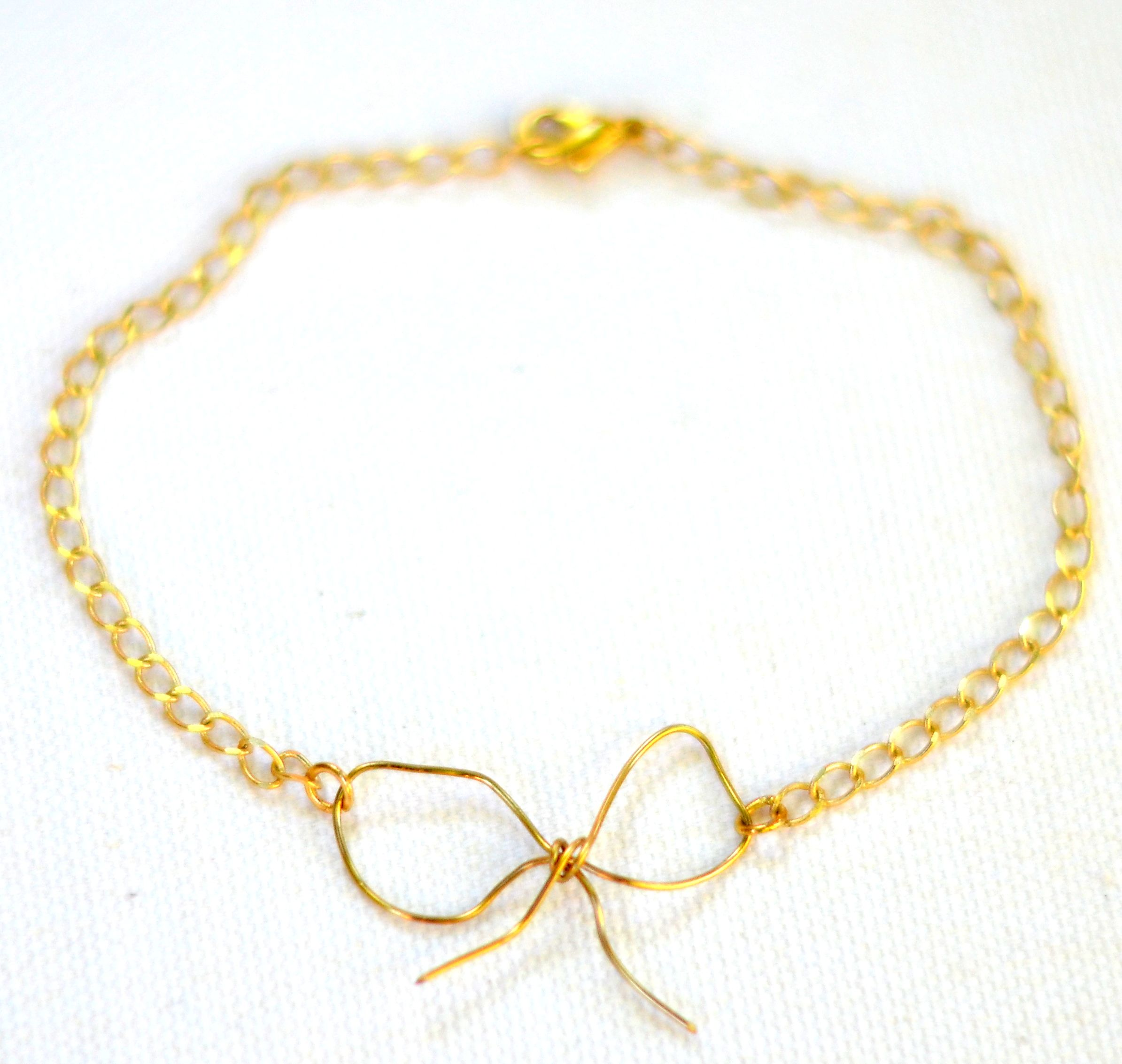 gallery gold diamond bow white jewelry kc lyst metallic designs in bracelet product