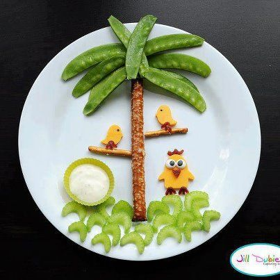 Palm tree snack made from pretzels, snow peas, celery, cheese, and dip