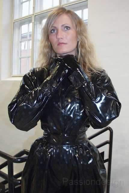 Tightly belted black pvc mackintosh